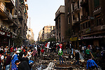 Protestors pick through Mohamad Mohamad street during a truce between the police and the protestors brokered by religious leaders and the military. Street battles raged around the heavily fortified Interior Ministry, near Tahrir square, with police and army troops using tear gas and rubber bullets to keep the protesters from storming the ministry..The clashes have left at least 38 killed and 2,000 protesters wounded, mostly from gas inhalation or injuries caused by rubber bullets fired by the army and the police. The United Nations strongly condemned what it called the use of excessive force by security forces.