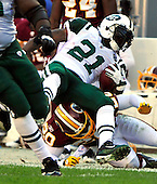 New York Jets running back LaDainian Tomlinson (21) is tackled by Washington Redskins safety Oshiomogho Atogwe (20) during the game at FedEx Field in Landover, Maryland on Sunday, December 4, 2011.  Tomlinson was injured on the play..Credit: Ron Sachs / CNP.(RESTRICTION: NO New York or New Jersey Newspapers or newspapers within a 75 mile radius of New York City)