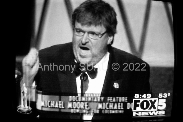 "Washington DC.USA.March 23, 2003..Film director Michael Moore speaks out against the Iraqi war as he receives the Academy Award for the best documentary film of the year, ""Bowling for Columbine""."