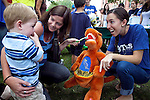 09/25/2011 - Medford/Somerville, Mass. - Tufts dental students teach kids how to brush teeth during Tufts University's Community Day on Sunday, September 25, 2011. (Everett Wallace for Tufts University)