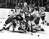 Seals Ron Stackhouse and Dick Redmond help goalie.Gary Smith against the Boston Bruins #11.(1971 photo/Ron Riesterer)