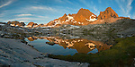 Panoramic shot of sunrise and reflection at the base of Ritter peak as seen from the headwaters above Nydiver Lake in the Ansel Adams wilderness. This was day 4 of a 5 day cross country route that was a version on the popular Minaret Lake-Thousand Island Lake loop.