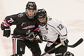 Kendall Coyne (NU - 77), Jessica Vella (PC - 12) - The Northeastern University Huskies defeated the visiting Providence College Friars 8-7 on Sunday, January 20, 2013, at Matthews Arena in Boston, Massachusetts.