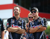 Jun 21, 2015; Bristol, TN, USA; NHRA pro stock driver Greg Anderson (left) with his wife Kim Anderson and their son during the Thunder Valley Nationals at Bristol Dragway. Mandatory Credit: Mark J. Rebilas-