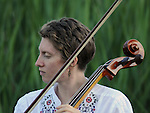 Cellist, Sharon Penz, of Mamalama, performing at Saugerties Sunset Concert at Glasco Mini Park, NY on Friday, July 1, 2011. Photo © Jim Peppler 2011.