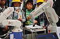 Nobember 9, 2011, Tokyo, Japan - School children view industrial robots during the International Robot Exhibition 2011 opened in Tokyo on Wednesday, November 9, 2011. The three-day trade show, sponsored by the Japan Robot Association, was designed promote new products and develop new business through contributing the promotion of new technology. (Photo by Natsuki Sakai/AFLO) [3615] -mis-..