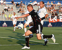 Danny Allsopp #9 of D.C. United moves the ball past Anthony Calvano #23 of the Harrisburg City Islanders during a US Open Cup match at the Maryland Soccerplex on July 21 2010, in Boyds, Maryland. United won 2-0.