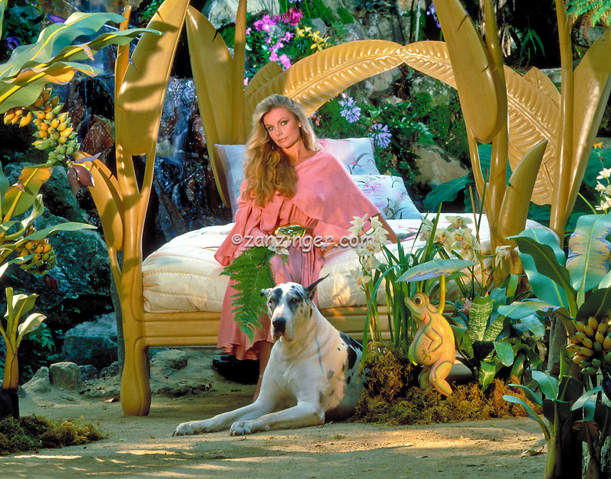 Bobbie Leonard, Interior Designer, Portrait, woman sitting on Palm Leafed Bed, Outdoor,  Great Dane, Awesome