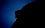 This is a 35 MM slide that has been digitized - Silhouette of the Old Man of the Mountain profile. Discovered in 1805 the Old Man profile was the main attraction of Franconia Notch until it collapsed on May 3, 2003. This profile was on the side of Cannon Mountain in Franconia Notch, New Hampshire USA.