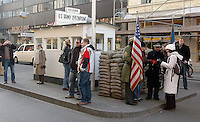 Tourists visit Checkpoint Charlie in Berlin, Germany on December 28, 2008. Checkpoint Charlie became a symbol of the Cold War, representing the separation of east and west, and for some East Germans, a gateway to freedom. (Photo by Alan Greth)