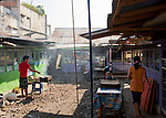 A local food stall owner prepares his first course, outside his shop in Bitung City, North Sulawesi, Indonesia.