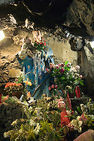 Nicolosi, Etna, Sicily, June 2006. The Etna erupts almost every other year. This Madonna is a place of worship. She was burried under lava but miraculously survived. Climbing it, one can peek into the steaming craters. The volcanoes of Southern Italy offer a spectacular landscape for trekking while staying in picturesque towns. Photo by Frits Meyst/Adventure4ever.com