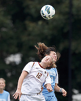 Boston College midfielder Jana Jeffrey (12) and University of North Carolina midfielder Brooke Elby (93) battle for head ball.   University of North Carolina (blue) defeated Boston College (white), 1-0, at Newton Campus Field, on October 13, 2013.