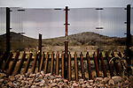 Scenes from the US-Mexico Border between Douglas and Nogales, Arizona.  The high, arid landscape dividing these two frontier towns serves as a major portal for undocumented immigrants as well as a thoroughfare for human and drug trafficking.  The Bush administration approved 2.7 billion dollars for the construction of a fence along the 2000 mile border area.  The fence is not contiguous and, at many points, shows obvious signs that it serves only as a hurdle not as a roadblock.  The Obama administration has yet to decide whether it will complete construction of the fence which, even according to its mandate, will not bridge the entire border, rather covering urban and high-traffic areas.  .