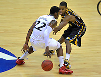Rashad Bishop of the Bearcats tries to dribble past a defender. Cincinnati defeated Missouri 78-63 during the NCAA tournament at the Verizon Center in Washington, D.C. on Thursday, March 17, 2011. Alan P. Santos/DC Sports Box