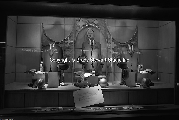 Pittsburgh PA: View of Christmas window display at Horne's department store in downtown Pittsburgh. Men's suits and accessories on display during the Rhapsody of Steel campaign. US Steel launched an awareness campaign of all the current uses of steel in everyday products.  During this time, ALCOA Aluminum Company of America also headquartered in Pittsburgh, was aggressively competing to enter markets where US  steel companies traditional dominated market share. Examples included beer and food Cans, appliances, automobile parts, children toys / bicycles, and more.