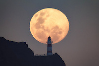 People gather at the base of the Cape Palliser Lighthouse in the Wairarapa, New Zealand, to view the biggest Supermoon rising for 2014.<br /> <br /> This is a singe exposure shot taken 3.7km away from the lighthouse.