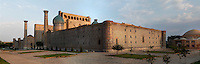 Panoramic view from behind of the Sher-Dor Madrasah, 1619-36, Samarkand, Uzbekistan, pictured on July 16, 2010, at sunrise. To the right is the Chorsu, dome-arched construction, 15th-18th century, the old shopping centre of the city. Samarkand, a city on the Silk Road, founded as Afrosiab in the 7th century BC, is a meeting point for the world's cultures. Its most important development was in the Timurid period, 14th to 15th centuries.