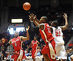 "Rutgers' Myles Mack (4), Rutgers' Wally Judge (33), and Mississippi's Reginald Buckner (23) go for the ball at the C.M. ""Tad"" Smith Coliseum in Oxford, Miss. on Saturday, December 1, 2012. (AP Photo/Oxford Eagle, Bruce Newman).."