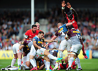 Danny Care of Harlequins box-kicks the ball as Maro Itoje of Saracens looks to charge him down. Aviva Premiership match, between Harlequins and Saracens on September 24, 2016 at the Twickenham Stoop in London, England. Photo by: Patrick Khachfe / JMP
