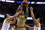 11 March 2016: Notre Dame's Demetrius Jackson (center) is defended by North Carolina's Brice Johnson (left) and Joel Berry II (right). The University of North Carolina Tar Heels played the University of Notre Dame Fighting Irish at the Verizon Center in Washington, DC in the Atlantic Coast Conference Men's Basketball Tournament semifinal and a 2015-16 NCAA Division I Men's Basketball game. UNC won the game 78-47.