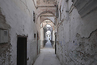 A narrow street with overhead archways in the Mellah or new Jewish quarter, which has a central street with parallel lanes running off it, built by the decree of Sultan Moulay Sliman on 5th August 1807, in the East of Tetouan, on the slopes of Jbel Dersa in the Rif Mountains of Northern Morocco. The original Jewish quarter was destroyed in 1790 by Sultan Moulay Yazid and the Jewish population of Tetouan is exclusively of Spanish origin, arriving first after the expulsions in the 15th century. Picture by Manuel Cohen
