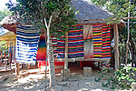 Colorful mexican blankets for sale at rustic shop