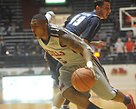 "Ole Miss guard Dundrecous Nelson (5)  dribbles as East Tennessee State's Adam Sollazzo (43) defends at the C.M. ""Tad"" Smith Coliseum in Oxford, Miss. on Saturday, December 18, 2010. Ole Miss won 71-50."
