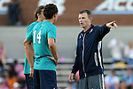 04 October 2016: UNCW's head coach Aidan Heaney (ENG) (right) talks to Brayden Smith (14). The University of North Carolina Tar Heels hosted the UNC Wilmington Seahawks at Fetzer Field in Chapel Hill, North Carolina in a 2016 NCAA Division I Men's Soccer match. UNC won the game 1-0.