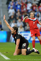 USWNT forward Abby Wambach (20) pleads for a penalty.