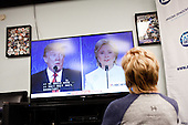 PHOENIX, ARIZONA, USA, 19/10/2016:<br /> Clinton supporters are watching the third debate between Donald Trump and Hillary Clinton, at the republican party headquarters.<br /> Arizona, traditionally very republican state, has become a swing state with both main candidates equally scoring in polls. (Photo by Piotr Malecki / Napo Images)