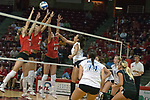 30 September 2006: Bulldog Eve Johnson strikes the ball past a trio of Redbird blockers. The Drake Bulldogs opened the match with a decisive win in the 1st game, but struggled in the next 3.  The Illinois State Redbirds took the match 3 games to 1.The match took place at Redbird Arena on the campus of Illinois State University in Normal Illinois.