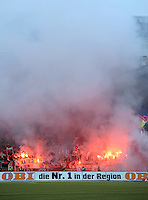 FUSSBALL   1. BUNDESLIGA  SAISON 2011/2012   22. Spieltag 1 FC Nuernberg - 1. FC Koeln       18.02.2012 Koeln Fankurve mit einem Bengalischen Feuer zum Fasching
