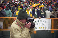 Longtime Green Bay Packers photographer Vernon Biever at work on the sidelines of Lambeau Field during the December 22, 1996 game against the Minnesota Vikings in which the Packers emerged victorious 38-10.