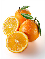 Fresh whole and cut oranges
