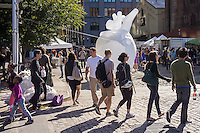 Visitors to the Brooklyn neighborhood of Dumbo during the annual Art Under the Bridge Dumbo Arts Festival on Saturday, September 28, 2013.  Dumbo has been a neighborhood shared by industry and artists but high real estate prices have created opportunities for development with the subsequent increase in rents.  (© Richard B. Levine)