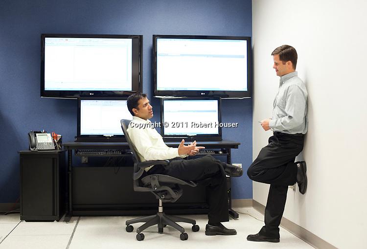Portrait of Serio Ferragut, software architect (blue) and Ariff Kassam, Product Manager Director (yellow) - Teradata Ariff Kassam - Teradata