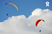 Two paragliders flying on cloudy sky (Licence this image exclusively with Getty: http://www.gettyimages.com/detail/104143539 )