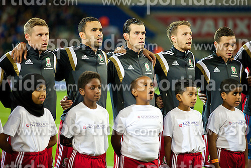 13.10.2014, City Stadium, Cardiff, WAL, UEFA Euro Qualifikation, Wales vs Zypern, Gruppe B, im Bild Wales' Simon Church, Hal Robson-Kanu, Gareth Bale, Chris Gunter and the mascots sing the national anthem // 15054000 during the UEFA EURO 2016 Qualifier group B match between Wales and Cyprus at the City Stadium in Cardiff, Wales on 2014/10/13. EXPA Pictures &copy; 2014, PhotoCredit: EXPA/ Propagandaphoto/ David Rawcliffe<br /> <br /> *****ATTENTION - OUT of ENG, GBR*****