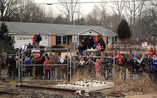 Baltimore, MD - January 17, 2009 -- Supporters watch as United States President-elect Barack Obama's train passes on the Whistle Stop Train Tour, outside of Baltimore, Maryland on Saturday, January 17, 2009. The ceremonial trip will carry President-elect Obama, Vice President-elect Biden and their families to Washington for their inaugurations with additional events in Philadelphia, Wilmington and Baltimore. Obama will be sworn in as the 44th President of the United States on January 20, 2009.  .Credit: Kevin Dietsch - Pool via CNP