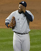 New York Yankees pitcher C.C. Sabathia (52) wipes his brow as he struggles in the second inning against the Baltimore Orioles at Oriole Park at Camden Yards in Baltimore, MD on Thursday, April 11, 2012.  .Credit: Ron Sachs / CNP.(RESTRICTION: NO New York or New Jersey Newspapers or newspapers within a 75 mile radius of New York City)