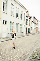 A young woman standing in a street in Brugge