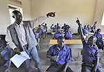 Teacher Okuamuzamil Juma questions students during class in a school in the Southern Sudanese village of Kenyi. The school was constructed by the United Methodist Committee on Relief (UMCOR).  Families here are rebuilding their lives after returning from refuge in Uganda in 2006 following the 2005 Comprehensive Peace Agreement between the north and south. NOTE: In July 2011, Southern Sudan became the independent country of South Sudan
