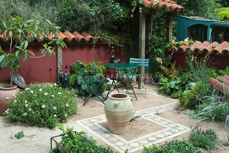 outdoor patio with sand and tiles using water wise succulent plants
