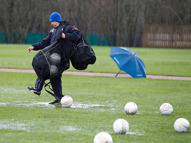 Kenny McDowall stepping gingerly over the puddles