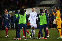 Lorient, France. - Sunday, February 8, 2015:  Abby Wambach (20) of the USWNT congratulates members of the French team after the match. France defeated the USWNT 2-0 during an international friendly at the Stade du Moustoir.