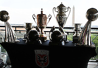 WASHINGTON, DC-JULY 10,2012:  DC United trophies in front of the Washington Monument during a D.C. United ownership press conference at the POV Lounge in the W Hotel, Washington, DC.