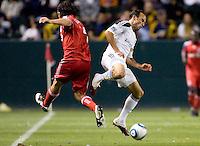LA Galaxy forward Landon Donovan (10) battles Toronto FC defender Nick Garcia (4). The LA Galaxy and Toronto FC played to a 0-0 draw at Home Depot Center stadium in Carson, California on Saturday May 15, 2010.  .