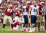 Defensive tackle Demonte McAllister (97) add the body english as Kicker Roberto Aguayo (19) watches his 53 yard field goal sail through the uprights as the FSU Seminoles defeat the Syracuse Orange 59-3 at Doak S Campbell Stadium in Tallahassee, Florida November 16, 2013.