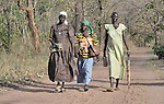 Women walking along a road in the Southern Sudan village of Yondoru. Families here are rebuilding their lives after returning from refuge in Uganda in 2006 following the 2005 Comprehensive Peace Agreement between the north and south.